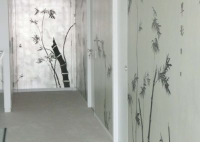"Steel fire door ""tied in"" to match silver leaf wallpaper."