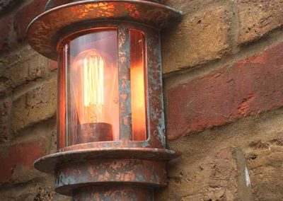 Verdigris copper paint effect to garden wall lights.