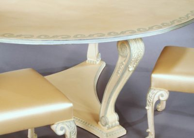 Hand painted dining table and 10 chairs. Silver leaf rubbed back.