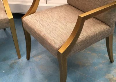 One of fourteen dining chairs, gilded in Dutch Metal and stipple glazed.