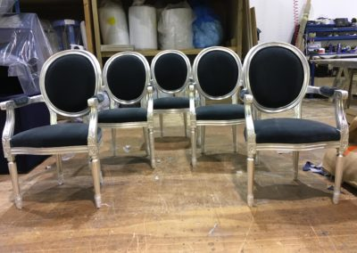 Fauteuils water gilded in silver leaf.
