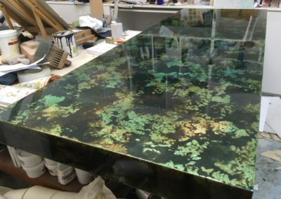 Oxidised Dutch Metal (brass leaf) table top. Wet look lacquer.