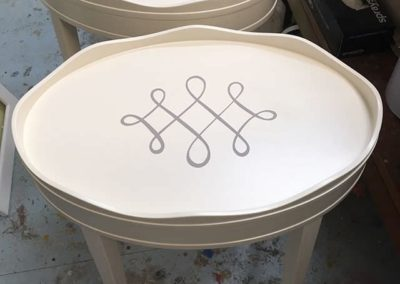 Painted scrol lside tables.