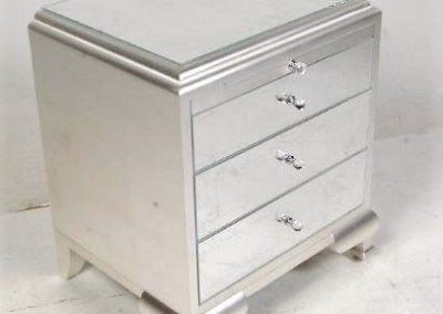 Silver leafed chest with gilded glass.