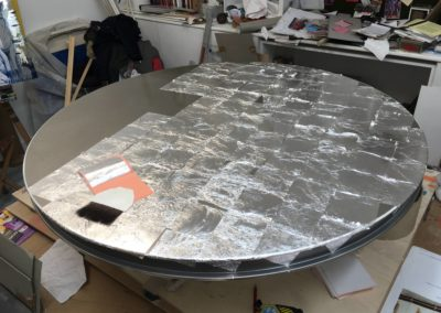 Silver leaf table; the gilding begins
