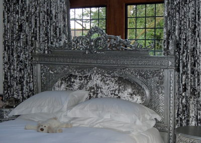 Silver leafed bed and side cabinets.