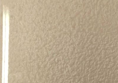 Textured pearlescent paint effect under water clear high gloss polished lacquer.