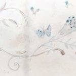 Faux antique vellum with textured decorative motifs.