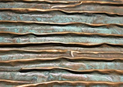 Ridged brass resin, with verdigris; For a bar front in Paris.